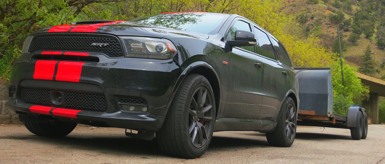 Dodge Durango SRT front right view low to the ground pulling a trailer.