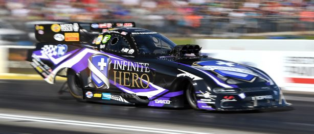 Jack Beckman racing his Infinite Hero Dodge Charger SRT Hellcat Funny Car at NHRA Heartland Nationals