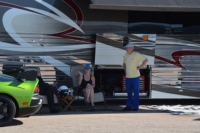 two people lounging in the shade of a trailer