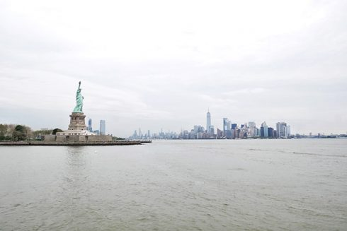the statue of liberty and the city skyline in the background