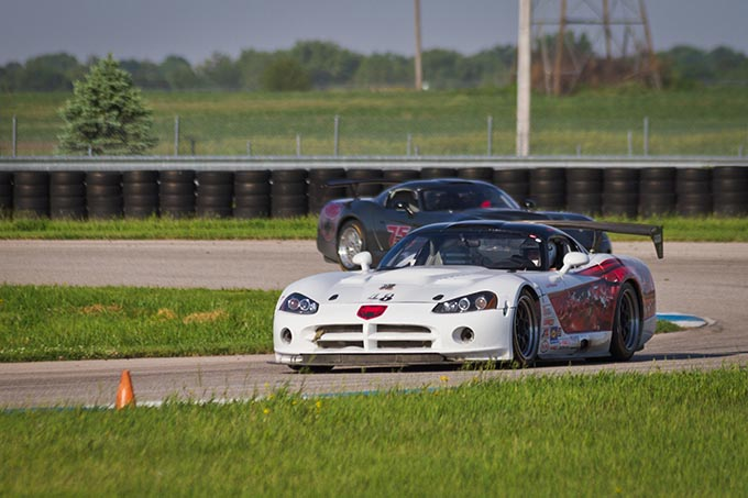 two dodge vipers driving around a race track