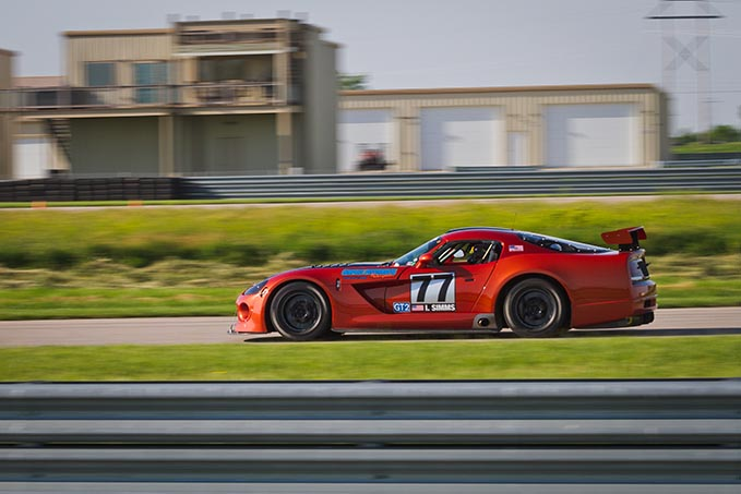 one dodge viper driving around a race track
