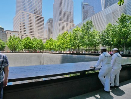 two soldiers looking at the nine eleven memorial
