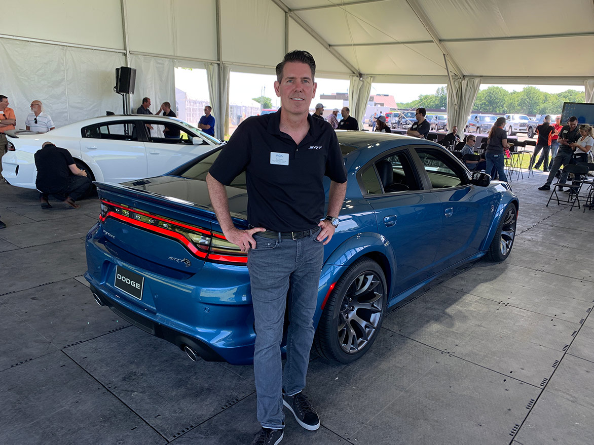one man standing in front of a 2020 Charger Hellcat Widebody