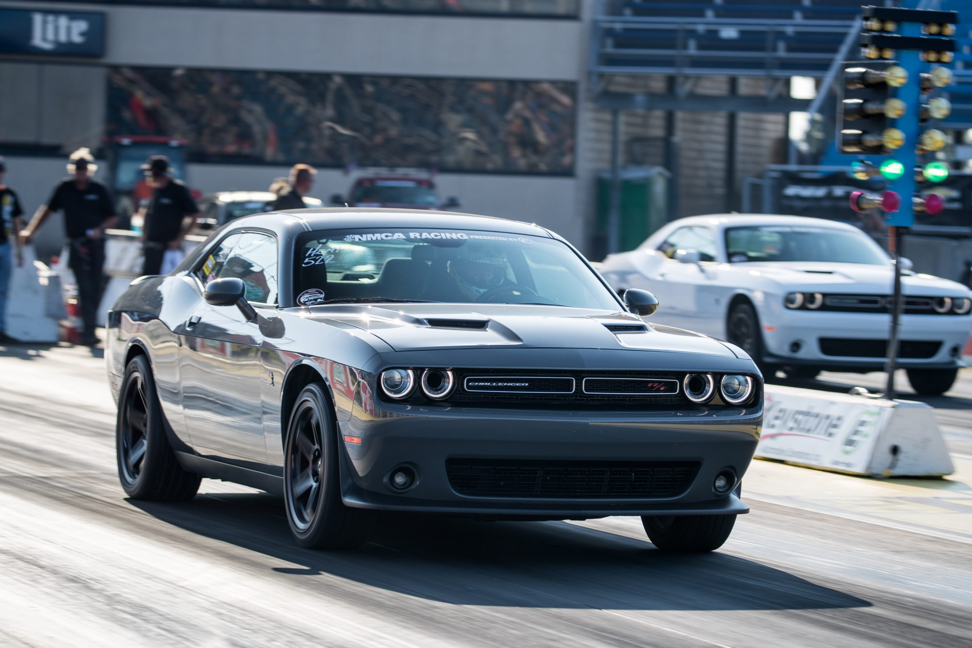 two dodge vehicles staging to drag race