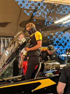 leah pritchett working on her top fuel dragtser