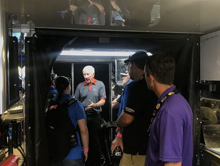 students getting a tour of a trailer