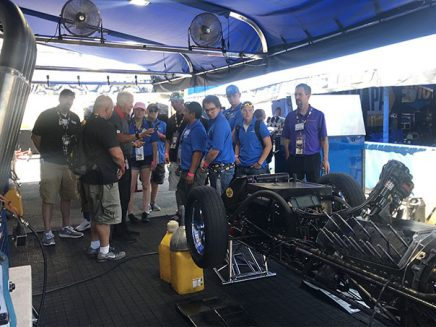 students getting a tour around a vehicle