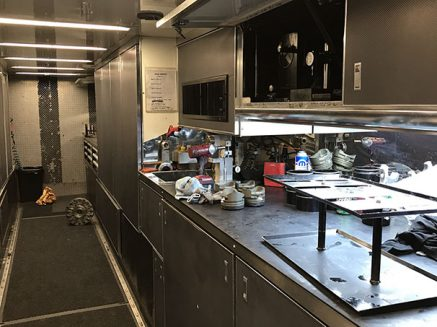 tools and vehicle parts inside matt hagan's trailer