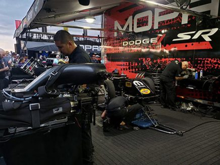 crew team working on matt hagan's funny car