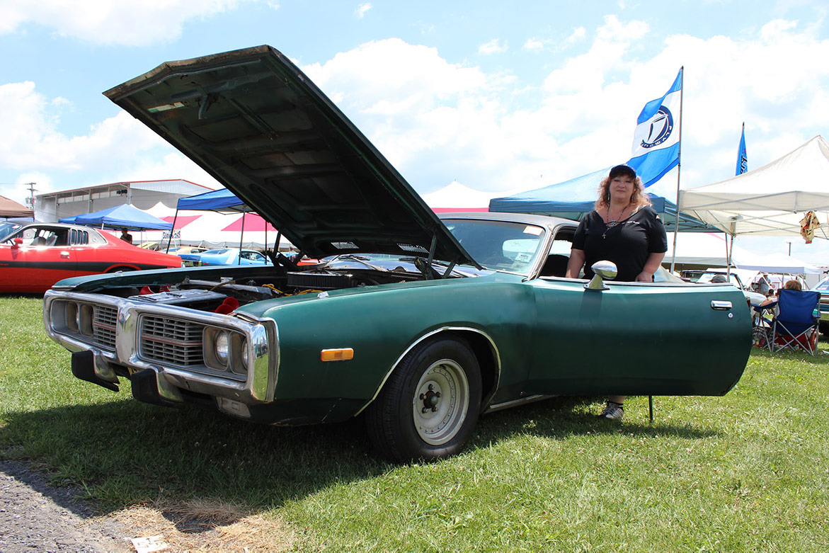 woman standing near her 1973 Dodge Charger SE