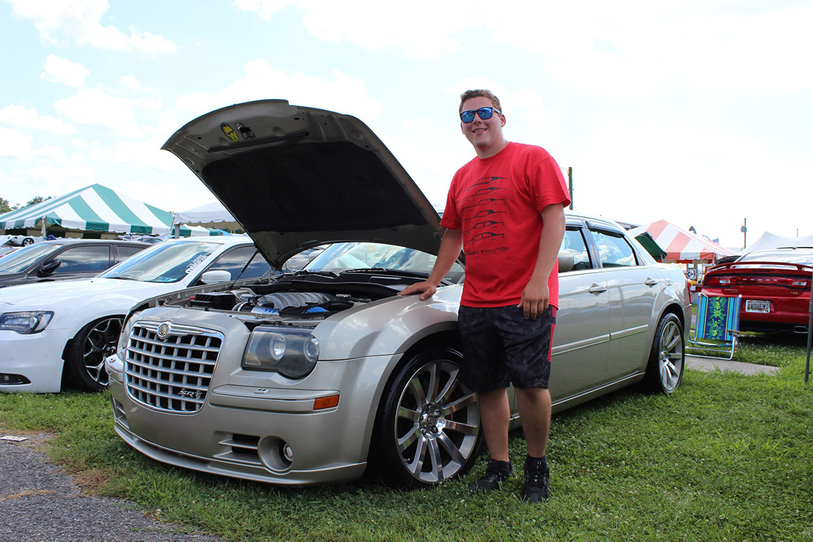 man standing next to his 2005 Chrysler 300