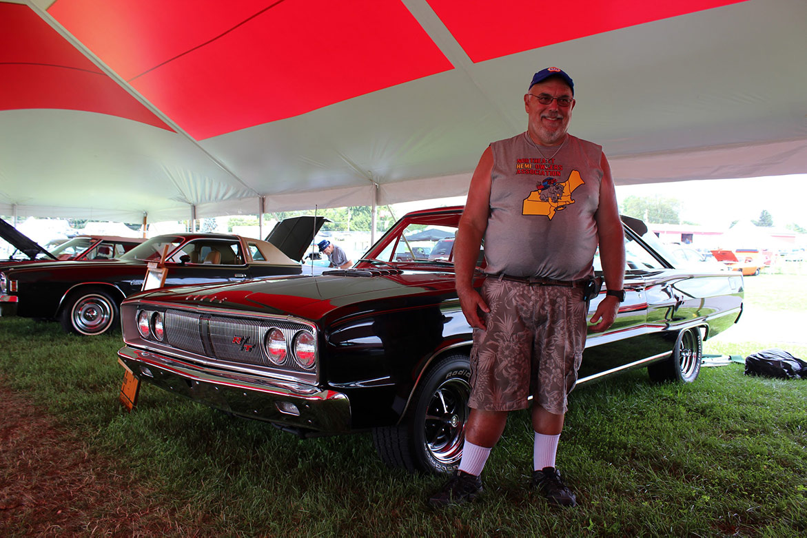 man standing next to his 1966 Coronet R/T Survivor HEMI Car