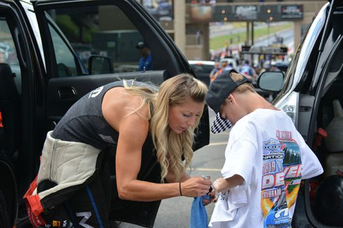 leah pritchett signing an autograph for a young boy