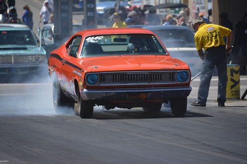 orange vehicle doing a burnout