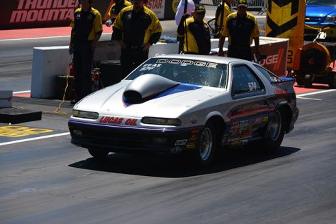 gray vehicle on the starting line of a drag strip