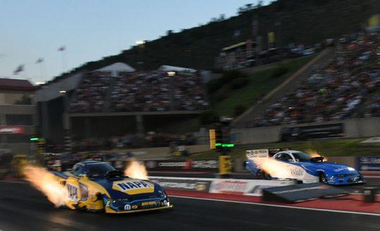funny car racing down the drag strip