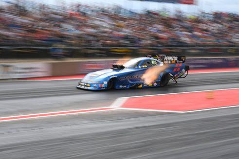 matt hagan's funny car racing down the drag strip