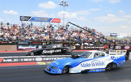 funny cars on the starting line