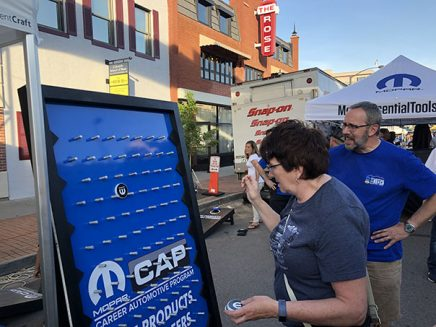 enthusiasts playing a mopar branded plinko game