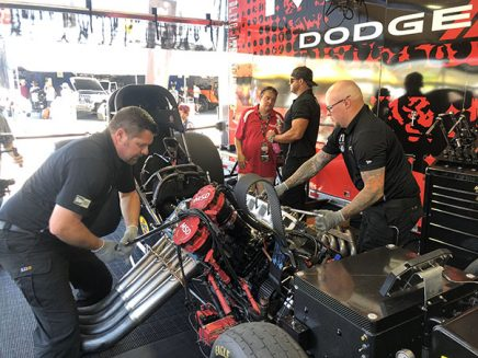 matt hagan with his crew team working on his funny car