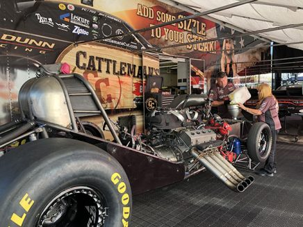 crew working on jim campbell's funny car