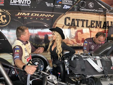 carmen electra being shown jim campbell's funny car