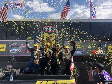 team holding trophies with confetti