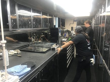 crew working inside tommy johnson jr's trailer
