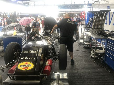 crew working on tommy johnson jr's funny car