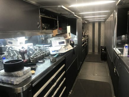 tools and vehicle parts inside jack beckman's trailer
