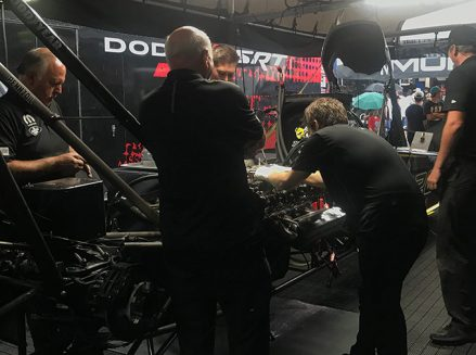 leah pritchett's crew team working on her top fuel dragster
