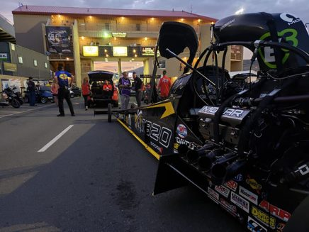 top fuel dragtser being transported to the drag strip