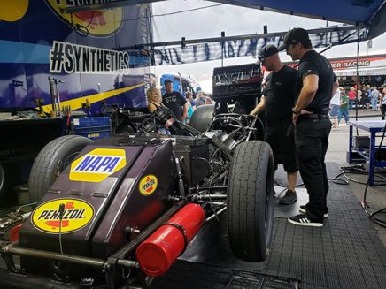 crew working on ron capps' funny car