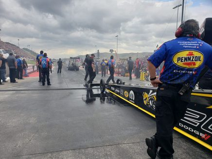 leah pritchett's top fuel dragster at the starting line of the drag strip
