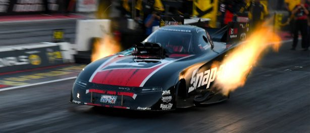 dodge charger srt hellcat funny car going down the drag strip