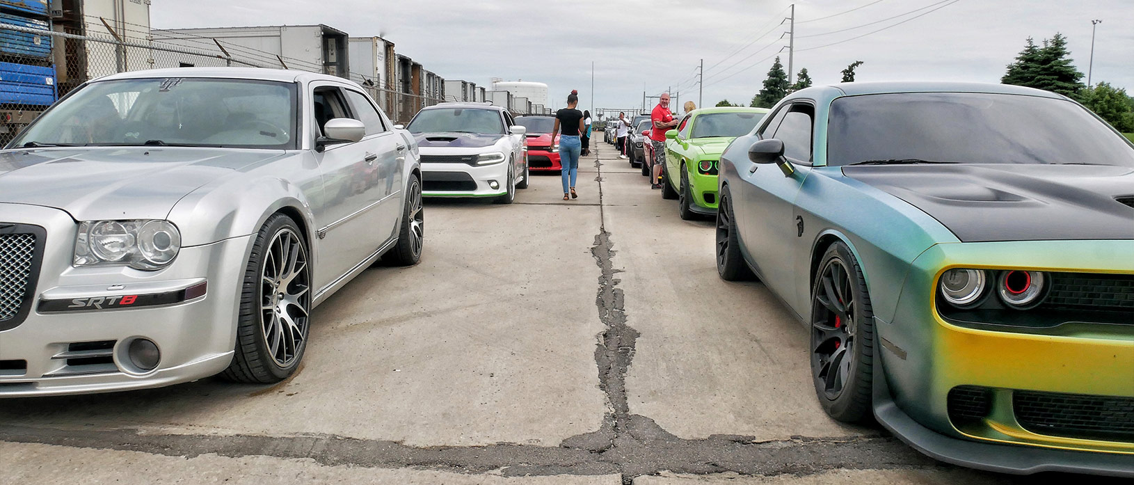 many vehicles parked in two parallel lines