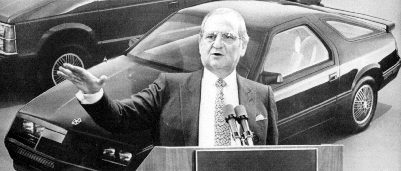 lee iaccoca speaking on a podium