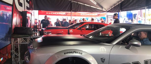 enthusiasts racing in srt demon simulators