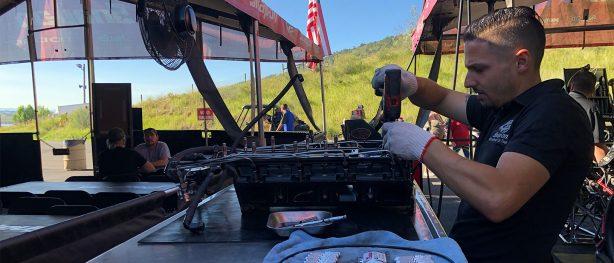 crew member workin in cruz pedregon's pit area