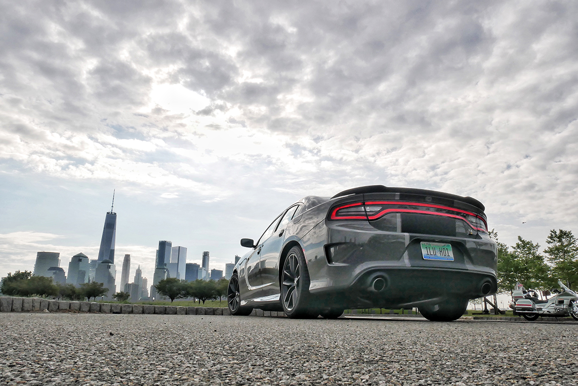 a gray charger with the city skyline in the background