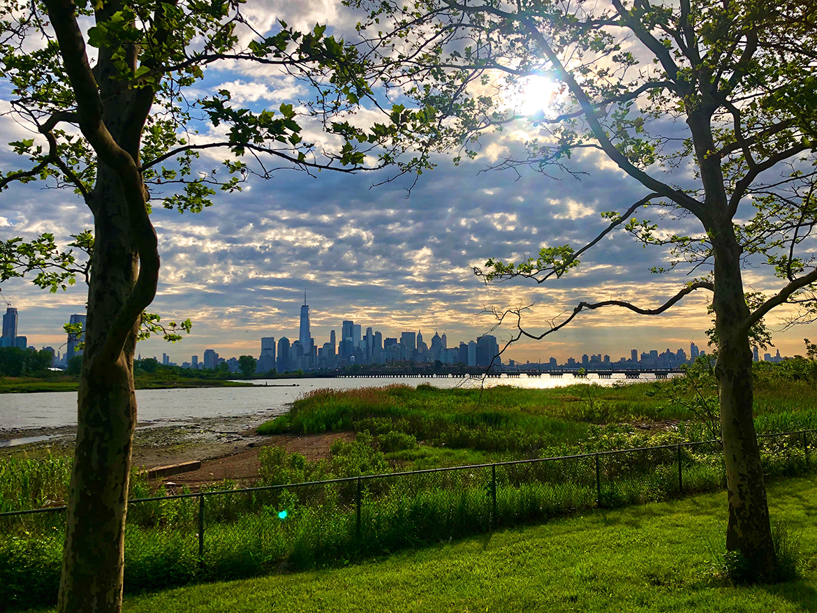 sunrise over the hudson river with the city skyline in the background