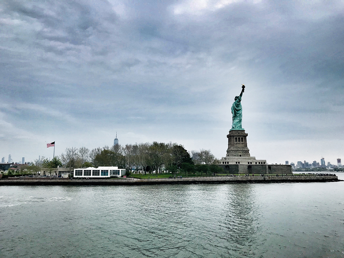 a view of liberty island from the hudson river