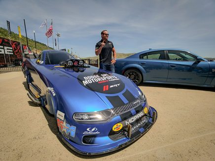 matt hagan standing next to his 2020 dodge charger srt hellcat widebody funny car