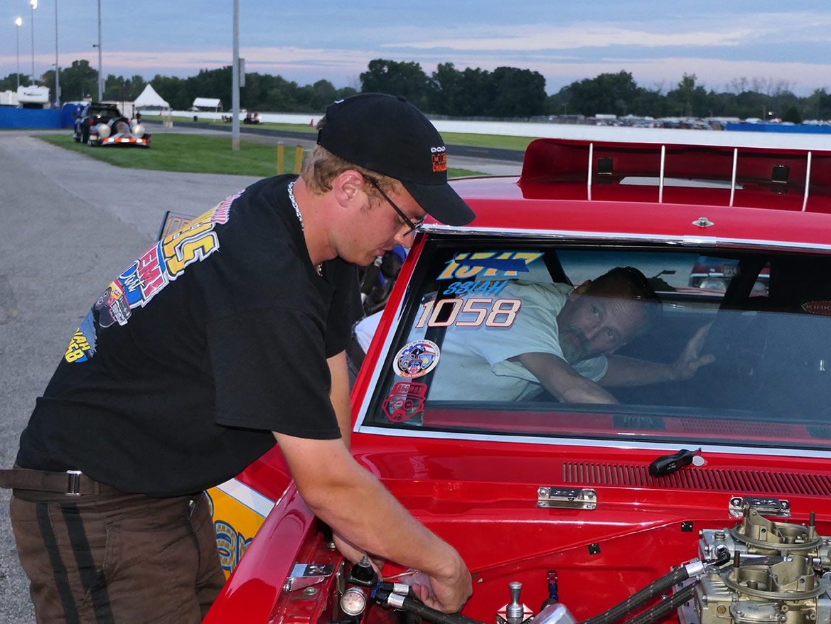 man working under the hood of his dodge vehicle