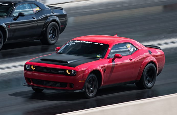 dodge vehicles racing down a drag strip