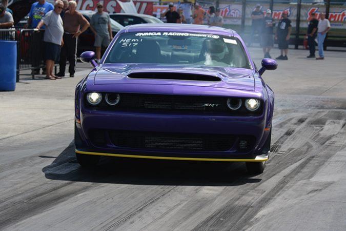 dodge vehicle racing down a drag strip