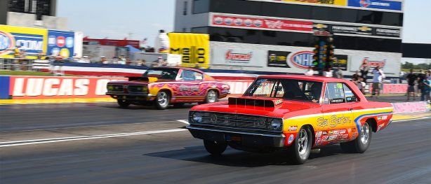 dodge vehicles at the starting line of a drag strip