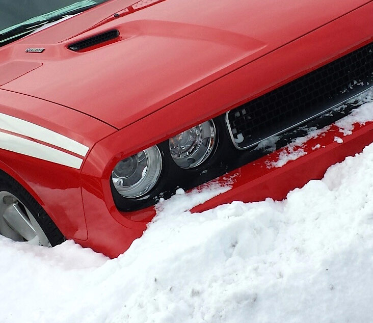 dodge vehicle parked in snow