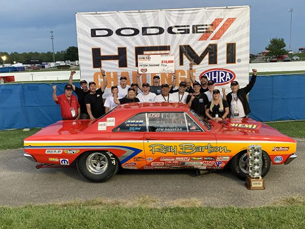 team of people with their dodge vehicle